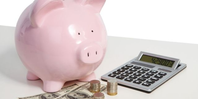 piggie bank and calculator