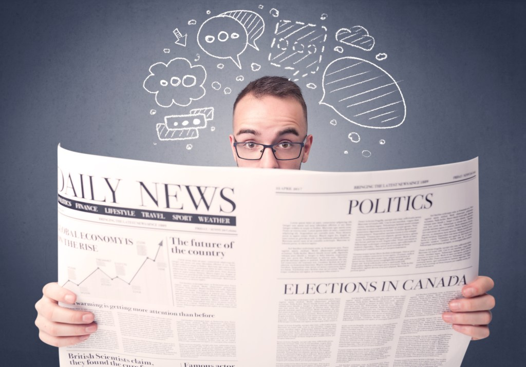 Man holding a newspaper with all kinds of negative emotional thought bubbles appearing above his head.