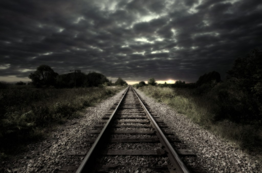 Railroad tracks stretching into distance. Beware the confidence that you know what is good for you...no one can see very far down the tracks