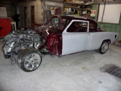 Body back on frame for the last time. I measured for clearance, Wheel opening, left, off of frame mounts.