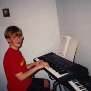 Greg at a piano lesson in 1991 at the home of Joyce Keedy, his first instructor.
