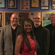 "Greg joined the stage with Jazz One for a performance of the ""Jazz On the Record"" show at An die Musik Live, celebrating the 100 year anniversary of recorded jazz. (left to right; Phil Ravita [bass], Tim Powell [sax], Deirdre Jennings [vox], Greg Small [piano], Ray Disney [trumpet], Nucleo Vega [drums])"