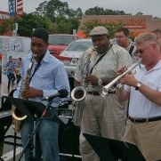Greg performed at the Music and Arts Grand Reopening in 2011. (left to right, Greg Small, saxophone lesson student, Greg Thompkins, James Meyer, John Blount, Bill Monroe)
