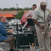 Greg joined guitarist James Meyer, saxophonist Greg Thompkins and others to perform at the Music and Arts Grand Reopening in 2011.