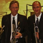 In 2012, Greg performed in a brass ensemble at the Johns Hopkins School of Advanced International Studies Commencement. (left to right; Frank Gorecki, Jeff Stockham, Greg Small, Stan Modjesky)