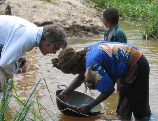 Greg Valerio with a woman gold miner in Sierra Leone.