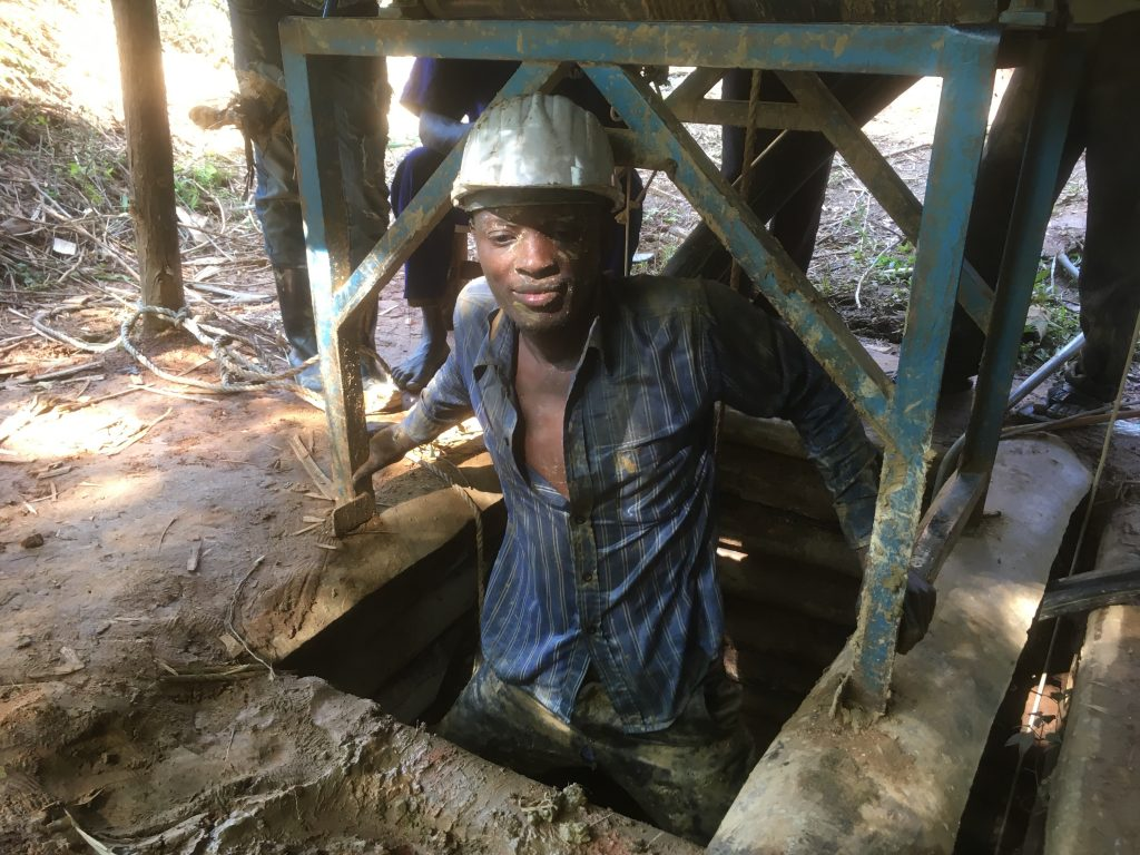 One of the Fairtrade Gold Uganda miners emerges from the timbered mine shaft at SAMA in Busia district Uganda.