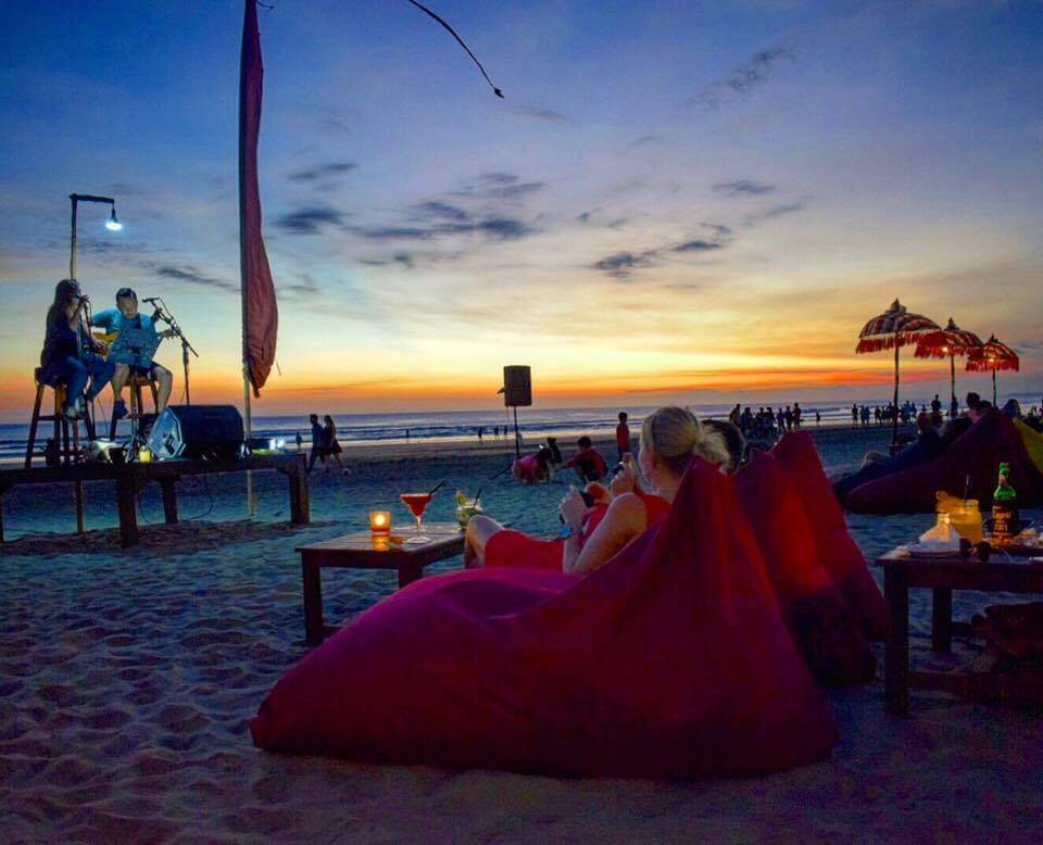 Dinner on the beach with a sunset view and live music