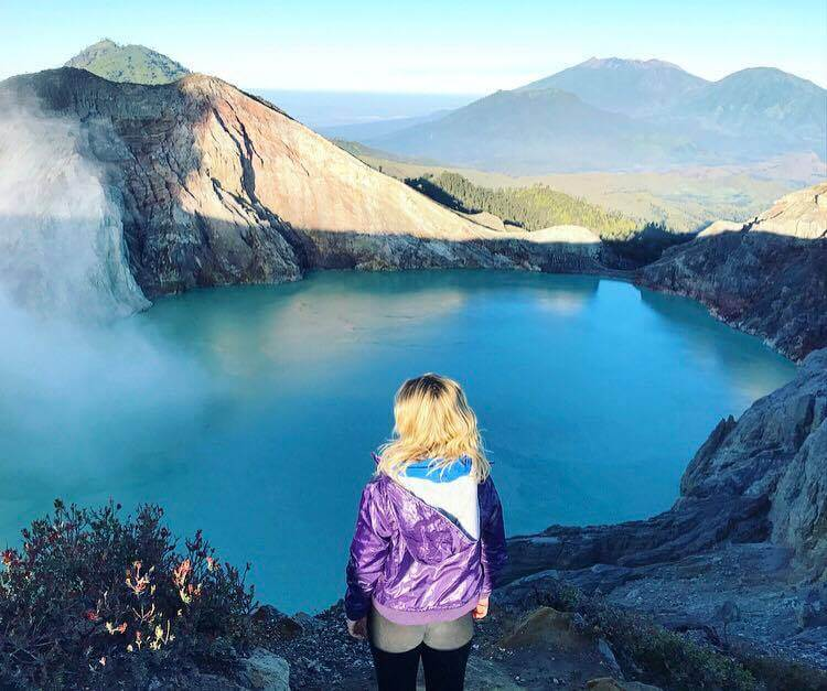Standing over the crater of Kawah Ijen, looking down at the biggest acidic lake in the world