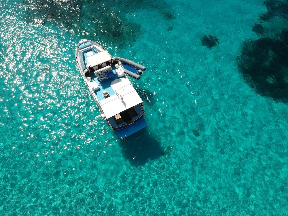 Our boat, the Blue Rider, floating in clear blue water.Our boat, the Blue Rider, floating in clear blue water.