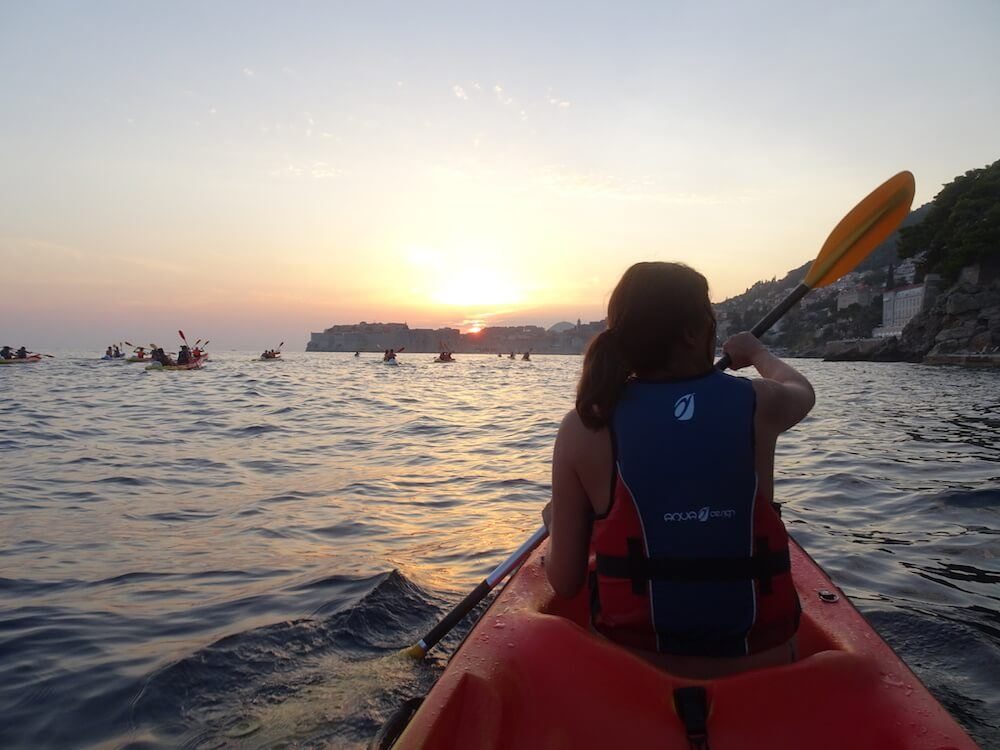 Kayaking at sunset by the harbour of Dubrovnik