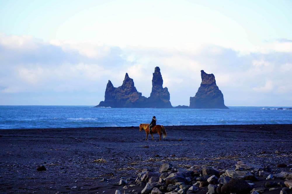 Horseriding on the black beach, photo by Nomad by Trade