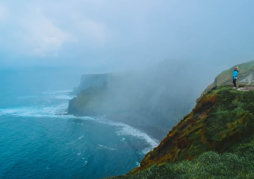 Standing on the edge of the Cliffs of Moher