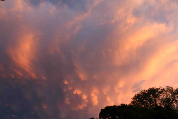 A gathering storm at sunset