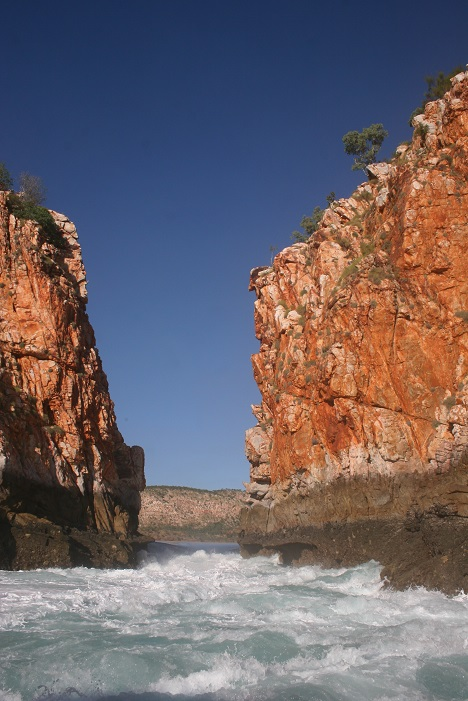 Water churns through the gap in the cliffs at Horizontal Falls