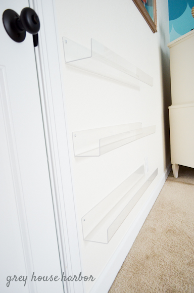 affordable book storage, clear wall shelves     greyhouseharbor.com