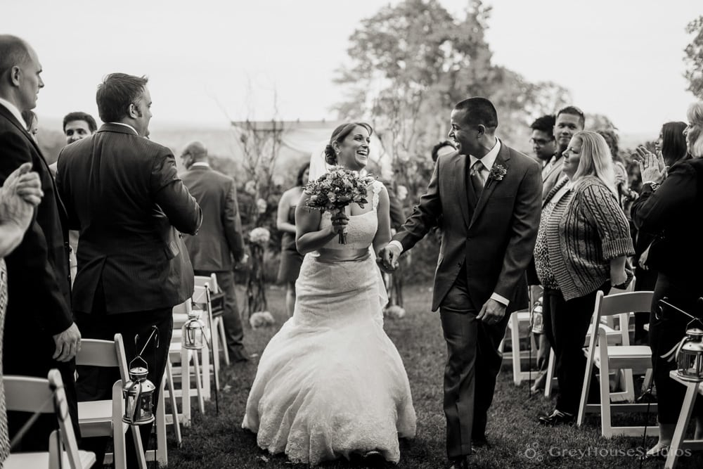 priam vineyards wedding photos bride groom running down aisle after ceremony