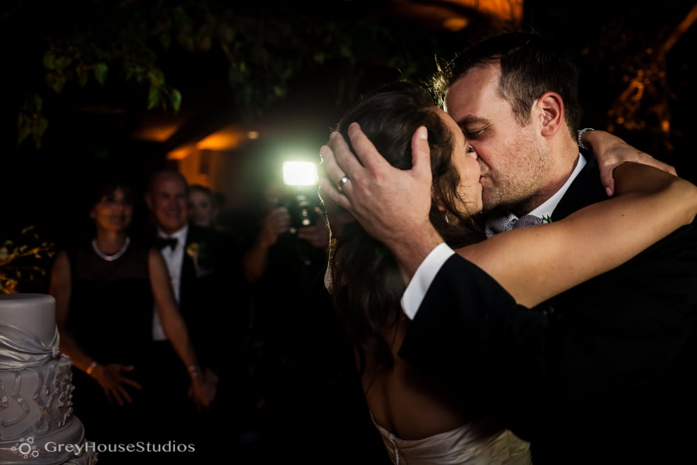 winvian wedding reception bride groom kissing after cutting cake photos