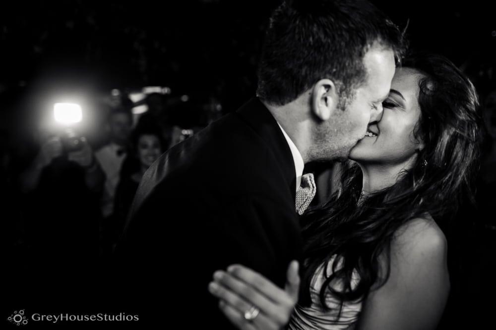 winvian wedding reception bride groom kissing after cutting cake photos
