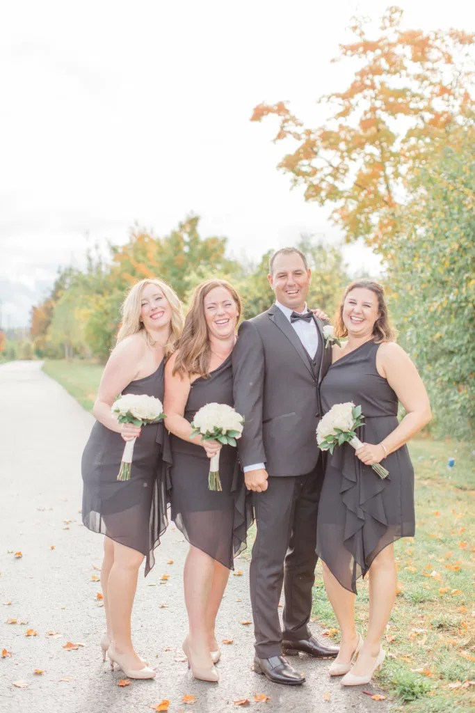Bridesmaids with Groom Pose - Having Fun with Bridesmaids - Black Bridesmaids Dresses for Curves - Holy Spirit Catholic Church Stittsville - Bride with Bridesmaids - Black and White Theme Wedding - Romantic Wedding at NeXt in Stittsville - Grey Loft Studio - Ottawa Wedding Photographer - Ottawa Wedding Photo & Video Team