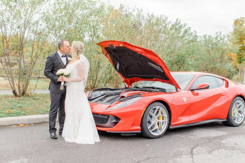 Posing with Red Ferrari - Bride and Groom Natural Posing - Having Fun with Bridesmaids - Black Bridesmaids Dresses for Curves - Holy Spirit Catholic Church Stittsville - Bride with Bridesmaids - Black and White Theme Wedding - Romantic Wedding at NeXt in Stittsville - Grey Loft Studio - Ottawa Wedding Photographer - Ottawa Wedding Photo & Video Team