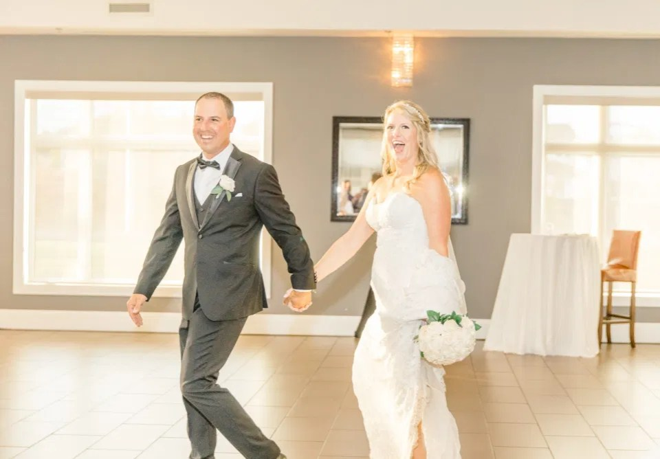 Bride and Groom Grand Entrance - Bride and Groom Natural Posing - Having Fun with Bridesmaids - Black Bridesmaids Dresses for Curves - Holy Spirit Catholic Church Stittsville - Bride with Bridesmaids - Black and White Theme Wedding - Romantic Wedding at NeXt in Stittsville - Grey Loft Studio - Ottawa Wedding Photographer - Ottawa Wedding Photo & Video Team