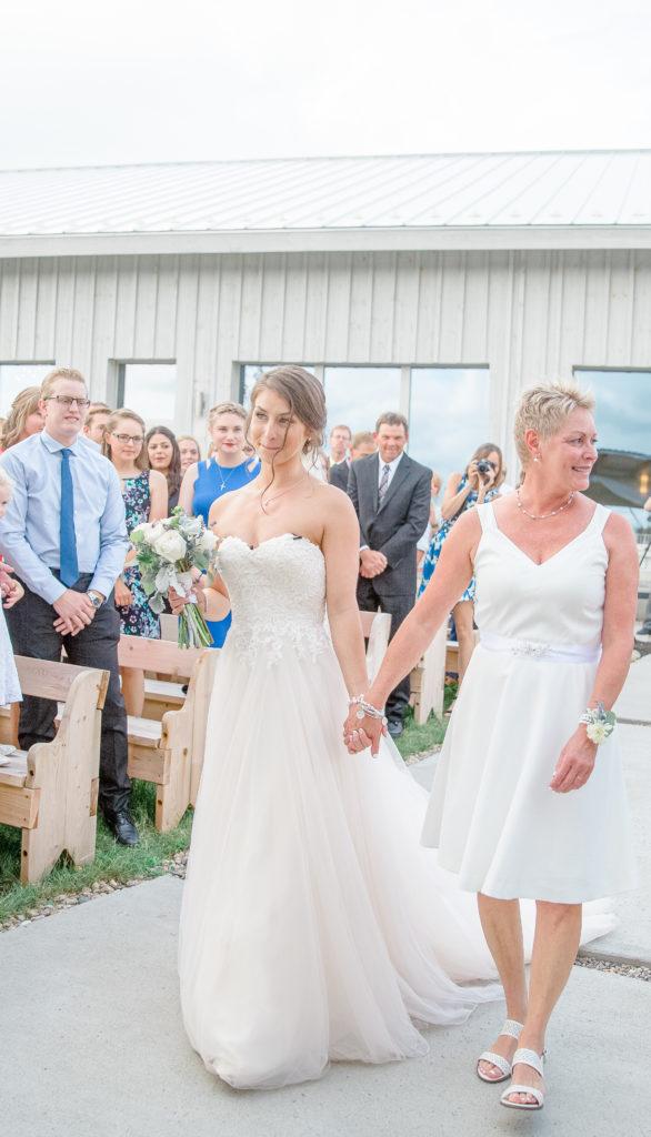Bride looking at her future husband walking down the Aisle - Lavender Rain Inspired Wedding - Le Belvedere- Grey Loft Studio- Ottawa Wedding Photographer - Affordable - Cheap - Fine Art - Best - Kanata Photographer - Wedding Videographer Ottawa - Light and Airy - Beautiful - Timeless - Organic Photographer Carp - Stittsville