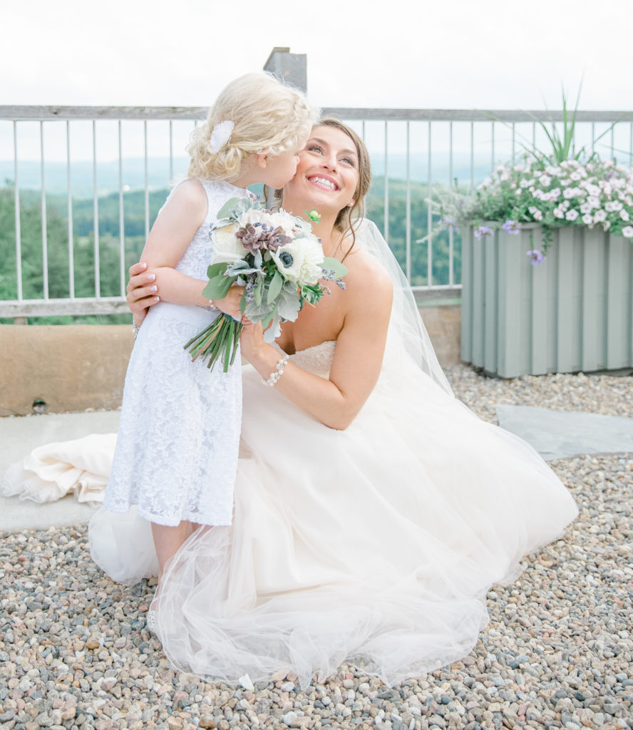 Flower Girl Kissing Bride on her Wedding Day - Lavender Rain Inspired Wedding - Le Belvedere- Grey Loft Studio- Ottawa Wedding Photographer - Affordable - Cheap - Fine Art - Best - Kanata Photographer - Wedding Videographer Ottawa - Light and Airy - Beautiful - Timeless - Organic Photographer Carp - Stittsville