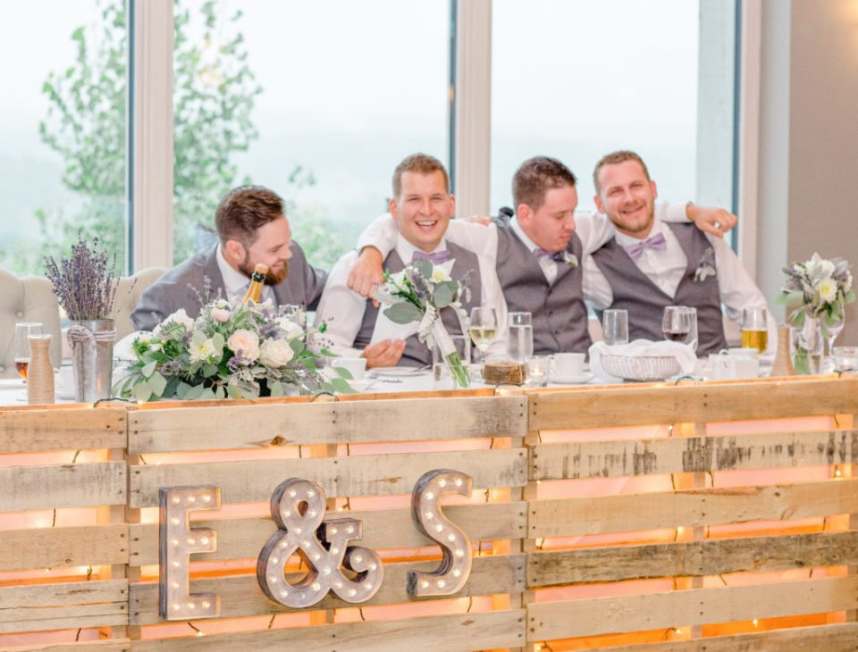 Groom and Groomsmen Having Fun at the Head Table - Reception Photos -  Lavender Rain Inspired Wedding - Le Belvedere- Grey Loft Studio- Ottawa Wedding Photographer - Affordable - Cheap - Fine Art - Best - Kanata Photographer - Wedding Videographer Ottawa - Light and Airy - Beautiful - Timeless - Organic Photographer Carp - Stittsville