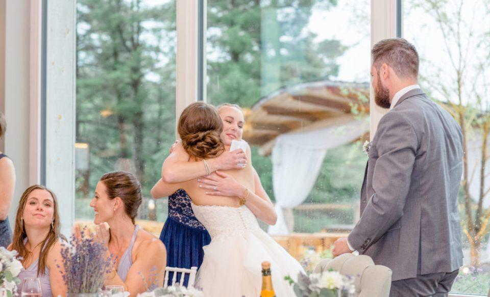 Hugs after an Emotional Speech at a Wedding - Reception Photos - Lavender Rain Inspired Wedding - Le Belvedere- Grey Loft Studio- Ottawa Wedding Photographer - Affordable - Cheap - Fine Art - Best - Kanata Photographer - Wedding Videographer Ottawa - Light and Airy - Beautiful - Timeless - Organic Photographer Carp - Stittsville
