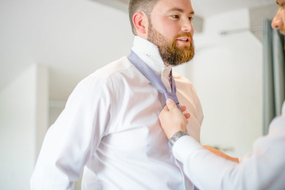 Getting Groom Prepped. - Tie on his Wedding Day - Lavender Rain Inspired Wedding - Le Belvedere- Grey Loft Studio- Ottawa Wedding Photographer - Affordable - Cheap - Fine Art - Best - Kanata Photographer - Wedding Videographer Ottawa - Light and Airy - Beautiful - Timeless - Organic Photographer Carp - Stittsville