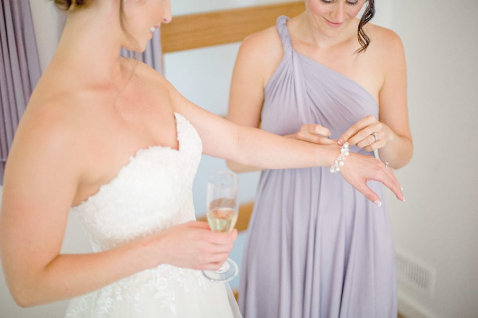 Bride getting help during Getting Ready - Lavender Rain Inspired Wedding - Le Belvedere- Grey Loft Studio- Ottawa Wedding Photographer - Affordable - Cheap - Fine Art - Best - Kanata Photographer - Wedding Videographer Ottawa - Light and Airy - Beautiful - Timeless - Organic Photographer Carp - Stittsville