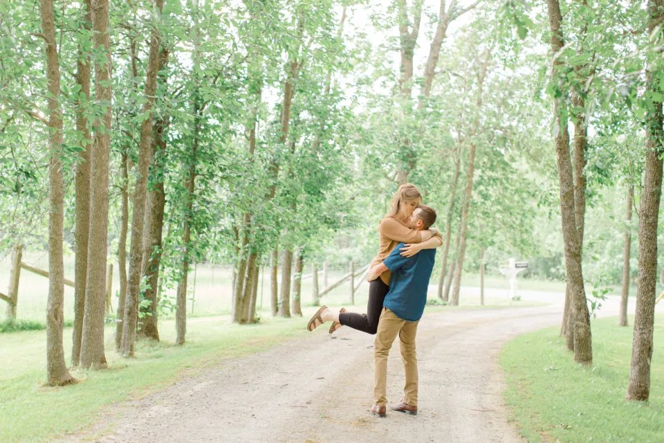 Frolic - Natural Posing for Photo Session - Couples Photo Session Fun - Fun on the Farm - Farm Engagement Session - Blue and Brown Engagement Session Inspiration - Natural Engagement Session Posing - Ideas for what to wear for Engagement Photography, Modern Engagement Session Inspiration Wardrobe Ideas. Unsure of what to wear for your engagement photos, we've got you! Romantic brown with black leggings for Summer Engagement in Almonte. Grey Loft Studio is Ottawa's Wedding and Engagement Photographer for Real couples, showcasing photos that are modern, bright, and fun.