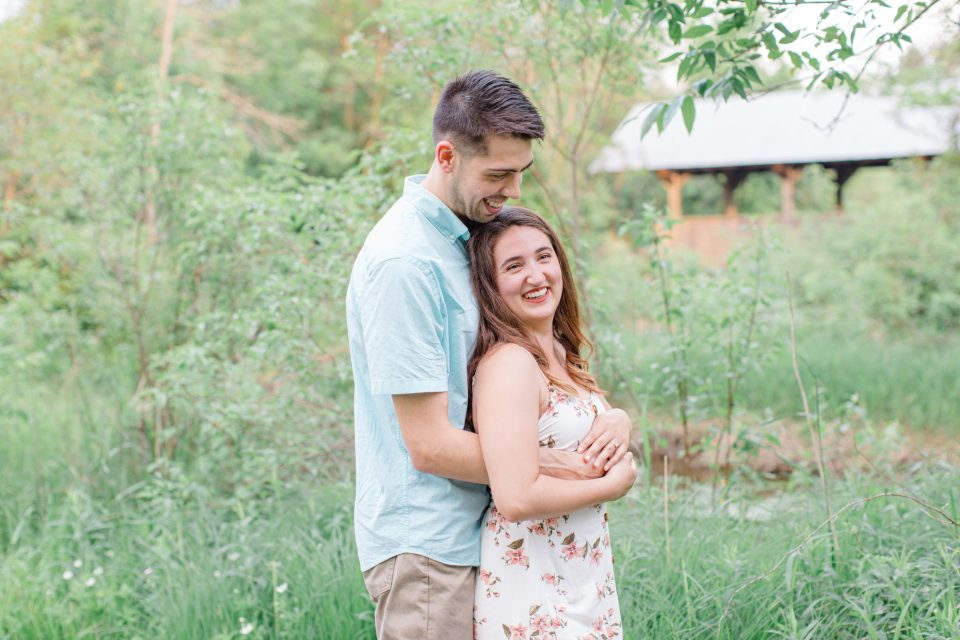 Cute Poses During your Engagement Session - Ideas for what to wear for Engagement Photography, Modern Engagement Session Inspiration Wardrobe Ideas. Unsure of what to wear for your engagement photos, we've got you! Romantic white with Pink Flower dress for Spring Engagement in Ottawa. Grey Loft Studio is Ottawa's Wedding and Engagement Photographer for Real couples, showcasing photos that are modern, bright, and fun.