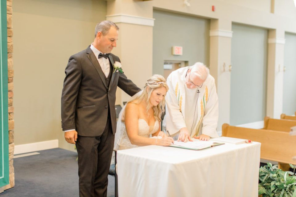 Signing the Altar - Holy Spirit Catholic Church Stittsville - Bride with Bridesmaids - Black and White Theme Wedding - Romantic Wedding at NeXt in Stittsville - Grey Loft Studio - Ottawa Wedding Photographer - Ottawa Wedding Photo & Video Team
