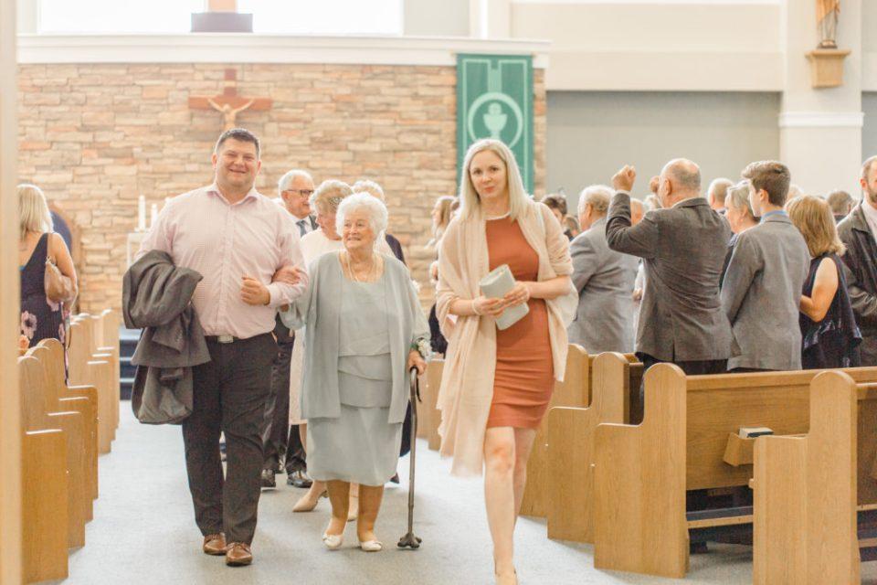 Guests walking Out - Holy Spirit Catholic Church Stittsville - Bride with Bridesmaids - Black and White Theme Wedding - Romantic Wedding at NeXt in Stittsville - Grey Loft Studio - Ottawa Wedding Photographer - Ottawa Wedding Photo & Video Team