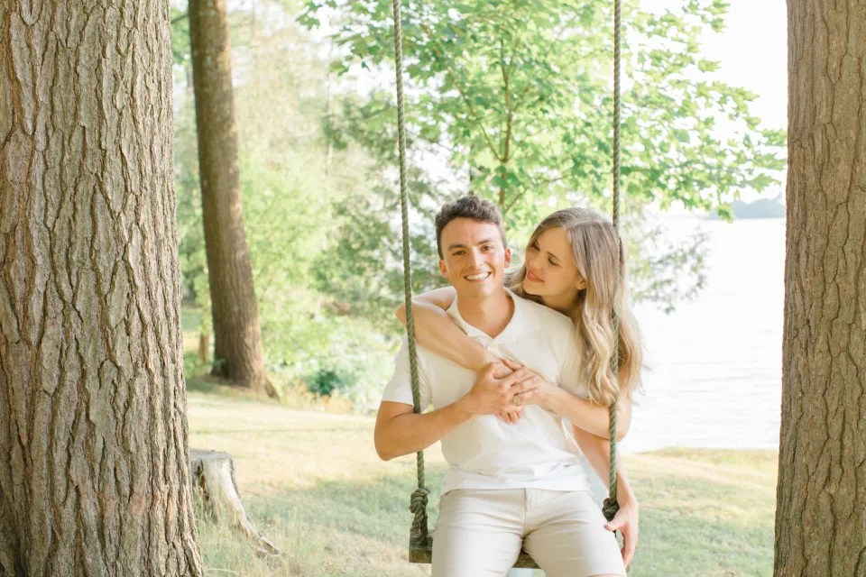Swing Photo Ideas - Ideas for what to wear for Engagement Photography, Modern Engagement Session Inspiration Wardrobe Ideas. Unsure of what to wear for your engagement photos, we've got you! Romantic blue Romper and neutral Shirts and polo. Boat Shoes and Flip Flops. Engagement in Gananoque. Grey Loft Studio is Ottawa's Wedding and Engagement Photographer Videographer for Real couples, showcasing photos that are modern, bright, and fun.