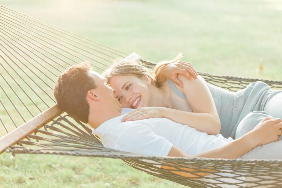 Hammock Photo Idea - Ideas for what to wear for Engagement Photography, Modern Engagement Session Inspiration Wardrobe Ideas. Unsure of what to wear for your engagement photos, we've got you! Romantic blue Romper and neutral Shirts and polo. Boat Shoes and Flip Flops. Engagement in Gananoque. Grey Loft Studio is Ottawa's Wedding and Engagement Photographer Videographer for Real couples, showcasing photos that are modern, bright, and fun.
