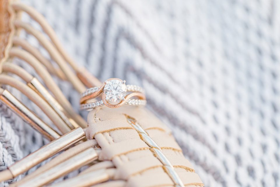 Ring Shot - Custom Ring - Rose Gold - Diamond Bands - Cute Poses on the beach in Water - Ideas for what to wear for Engagement Photography, Modern Engagement Session Inspiration Wardrobe Ideas. Unsure of what to wear for your engagement photos, we've got you! Romantic floral dress. Navy, Burgundy, & White T-shirt Polo & Navy shorts . Boat Shoes and Fancy. beaded sandals. Engagement at Britannia Beach, Nepean. Grey Loft Studio is Ottawa's Wedding and Engagement Photographer Videographer for Real couples, showcasing photos that are modern, bright, and fun.