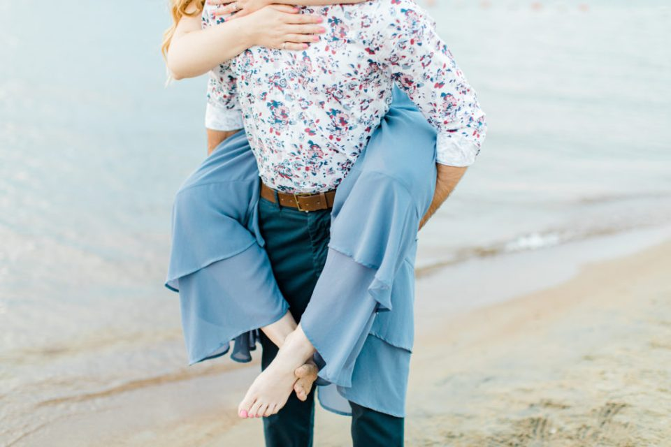 Cute Poses on the beach - Ideas for what to wear for Engagement Photography, Modern Engagement Session Inspiration Wardrobe Ideas. Unsure of what to wear for your engagement photos, we've got you! Romantic floral shirt & jeans.  White T-shirt & neutral pants . Boat Shoes and Fancy. beaded sandals. Engagement at Petrie Island, Orleans. Grey Loft Studio is Ottawa's Wedding and Engagement Photographer Videographer for Real couples, showcasing photos that are modern, bright, and fun.