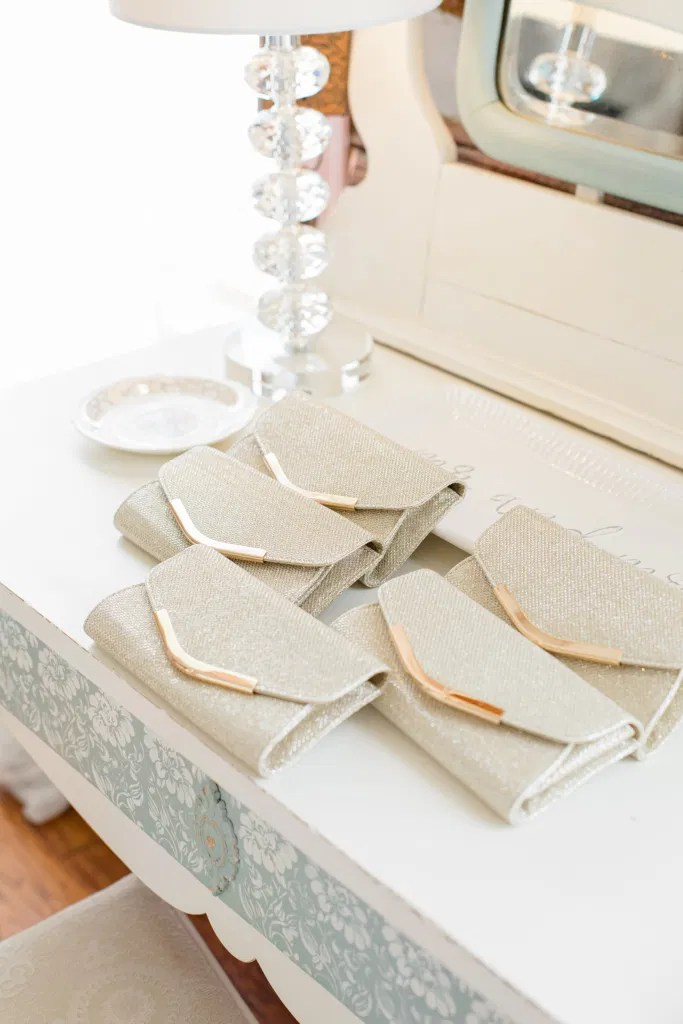 Matching Silver Clutches for Bridesmaids - Getting Ready Space - Stonefields Estate-  Bright and Airy -  Natural Wedding Posing - Ideas for what to wear for Blush Wedding Photography, Modern Wedding Blush &. Navy Wardrobe inspiration- Unsure of what to wear for your wedding, we've got you! Romantic white with greenery, blush and navy theme. Grey Loft Studio is Stonefields Wedding and Engagement Photographer for Real couples, showcasing photos that are modern, bright, and fun.