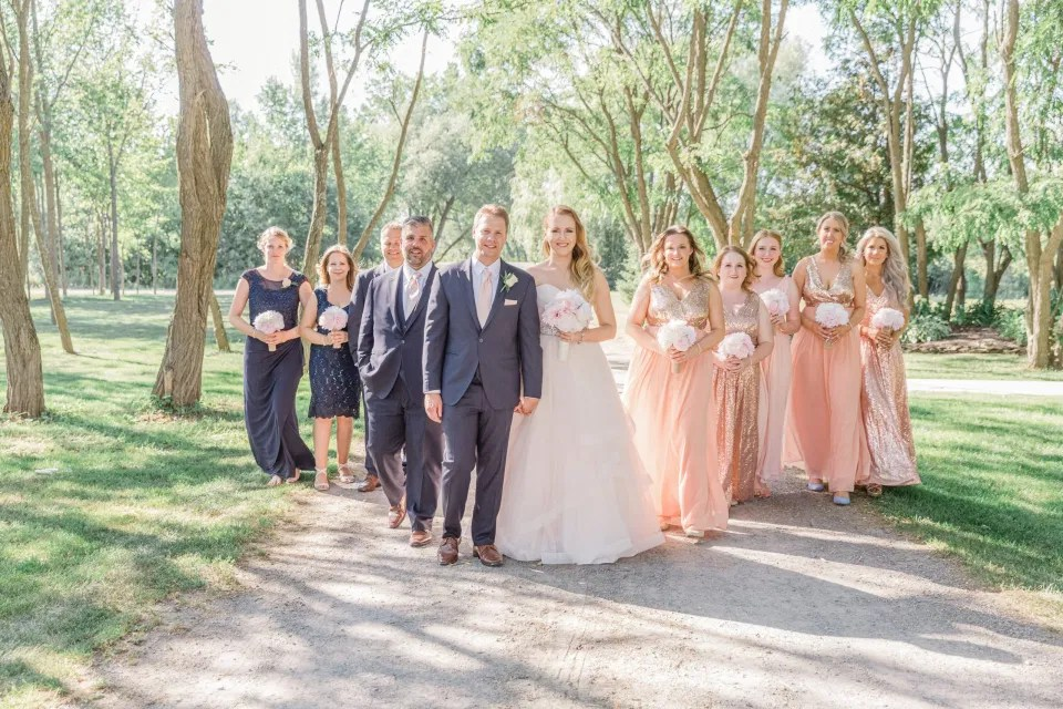 Bridal Party Photos after the Ceremony -  Stonefields Estate-  Bright and Airy - Natural Wedding Posing - Modern Wedding Blush &. Navy Wardrobe inspiration-  Romantic white with greenery, blush and navy theme. Grey Loft Studio is Stonefields Wedding and Engagement Photographer for Real couples, showcasing photos that are modern, bright, and fun.