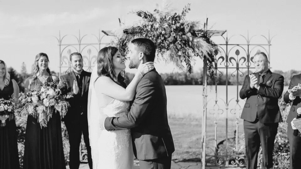 Just before the first Kiss - Bride and Groom standing at the Ceremony Site - Evermore Wedding and Events - Blue Sky, Fall Wedding. Grey Loft Studio Photography & Videography Ottawa
