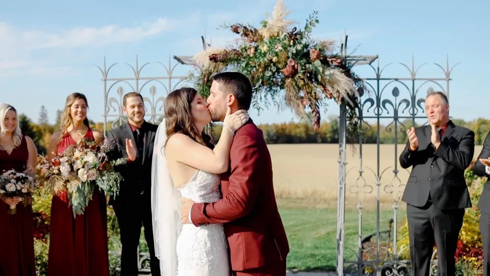 First Kiss Magic - Bride and Groom standing at the Ceremony Site - Evermore Wedding and Events - Blue Sky, Fall Wedding. Grey Loft Studio Photography & Videography Ottawa
