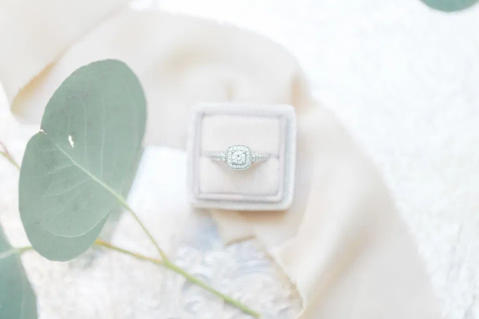 Wedding Ring Shot in Mrs. Box - Off-White, Silver, Greenery. Eucalyptus Leaves. An inspiration filled with soft neutrals, lush florals, and layers of romantic textures all set at Evermore Weddings and Events, Almonte Ontario.  Shot with Stephanie Mason Photography & Co + Grey Loft Studio.