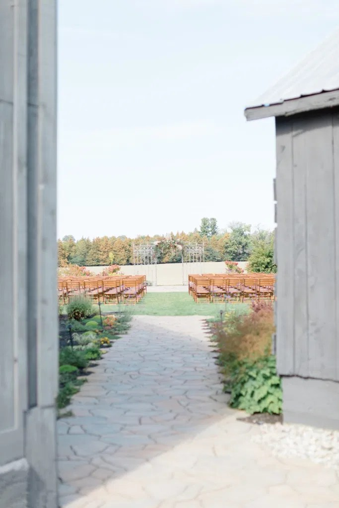 Outdoor Ceremony With Wooden Modern Brown Wood Chairs. Interlock, beautiful Landscapes at Evermore Weddings and Events, Almonte Ontario - Grey Loft Studio