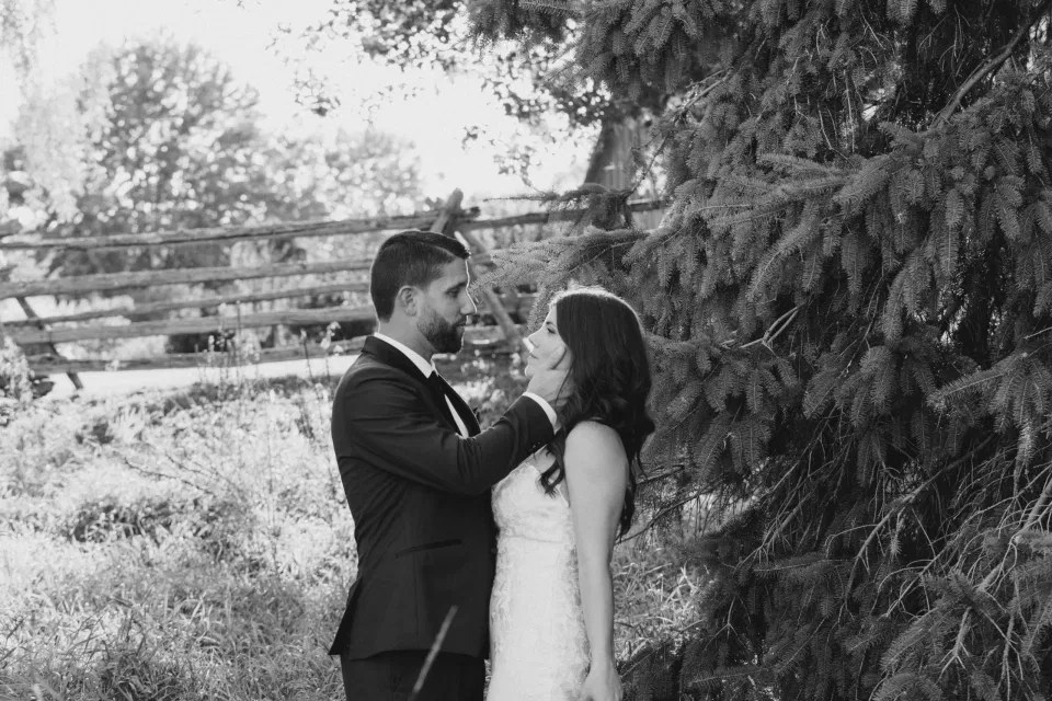 Black & White - Bride and Groom - Standing in a Field - Off-White, Silver, Greenery. Eucalyptus Leaves. An inspiration filled with soft neutrals, lush florals, and layers of romantic textures all set at Evermore Weddings and Events, Almonte Ontario.  Grey Loft Studio shot with Canon 5D Mark 4. Ottawa Wedding Photographer & Videographer Team.