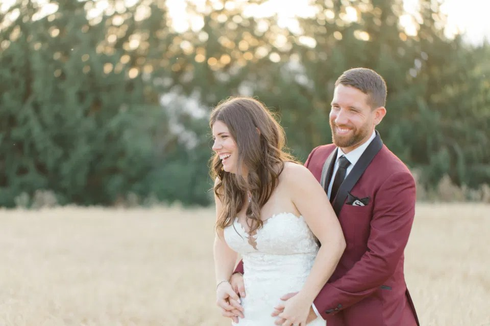 Fun Natural Wedding Poses - Holding Hands - Bride and Groom Posing at Sunset - Evermore Wedding and Events, Almonte - Bright, Modern, and Fun Wedding Photography. Grey Loft Studio . Wedding Photographer Ottawa.