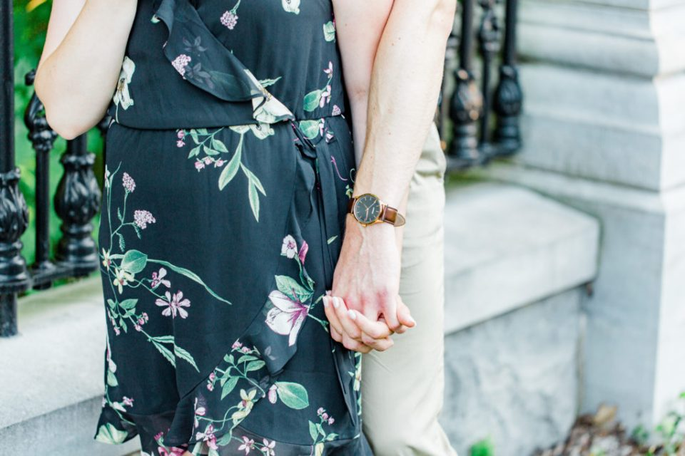 Holding Hands Shot - Engagement Photo Poses- Posing while at Rideau Hall - Ideas for what to wear for Engagement Photography, Modern Engagement Session Inspiration Wardrobe Ideas. Unsure of what to wear for your engagement photos, we've got you! Romantic floral dress. Black Polo T-shirt & neutral pants . Boat Shoes and Fancy beaded wedges. Engagement downtown Ottawa. Grey Loft Studio is Ottawa's Wedding and Engagement Photographer Videographer for Real couples, showcasing photos that are modern, bright, and fun.