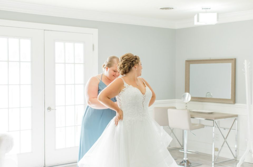 Bride getting in Dress - Orchard View Bridal Suite - Detail Photos for Micro Wedding - Ideas for what to wear for Wedding Photography, Modern Wedding Inspiration. Romantic Micro Wedding Orchard view - Grey Loft Studio is Ottawa's Wedding and Engagement Photographer for Real couples, showcasing photos that are modern, bright, and fun. Petite Wedding, Elopement Wedding, COVID Wedding Inspiration 2020